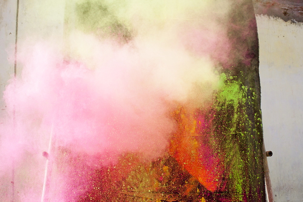 Powder paint spraying during Holi festival
