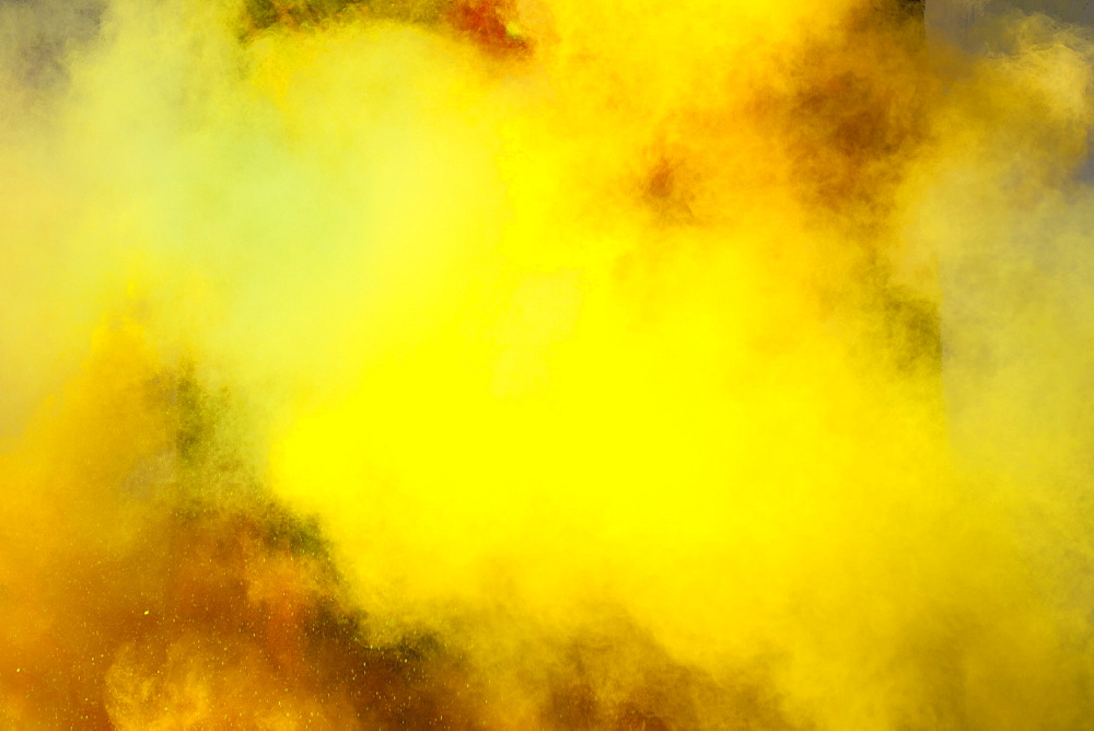 Yellow powder paint spraying during Holi festival