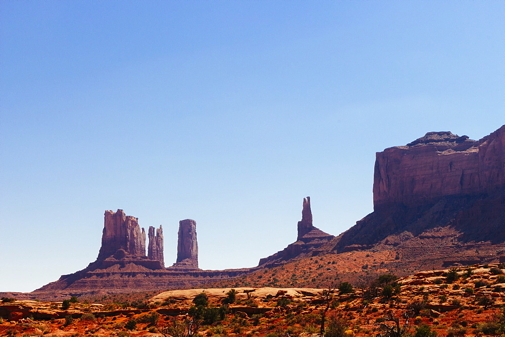 Monument Valley against clear blue sky