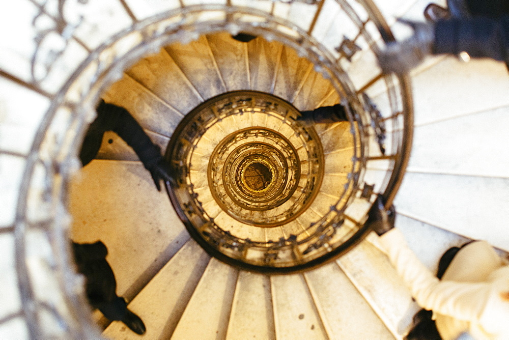 Directly above shot of people moving up spiral staircase in St. Stephen's Basilica