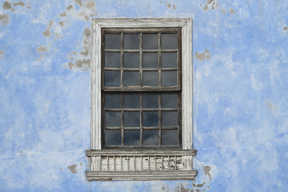 Window on weathered building