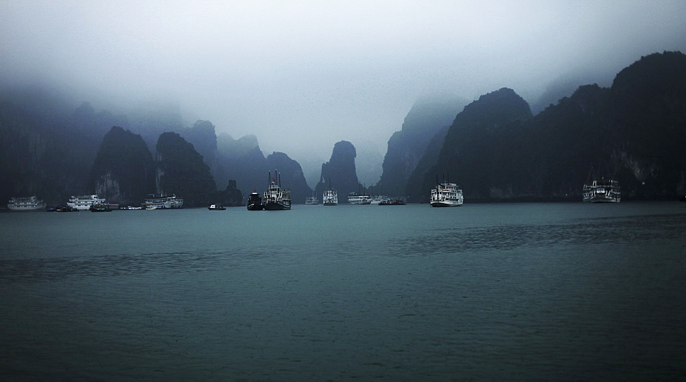 Boats at Halong bay against sky, Vietnam