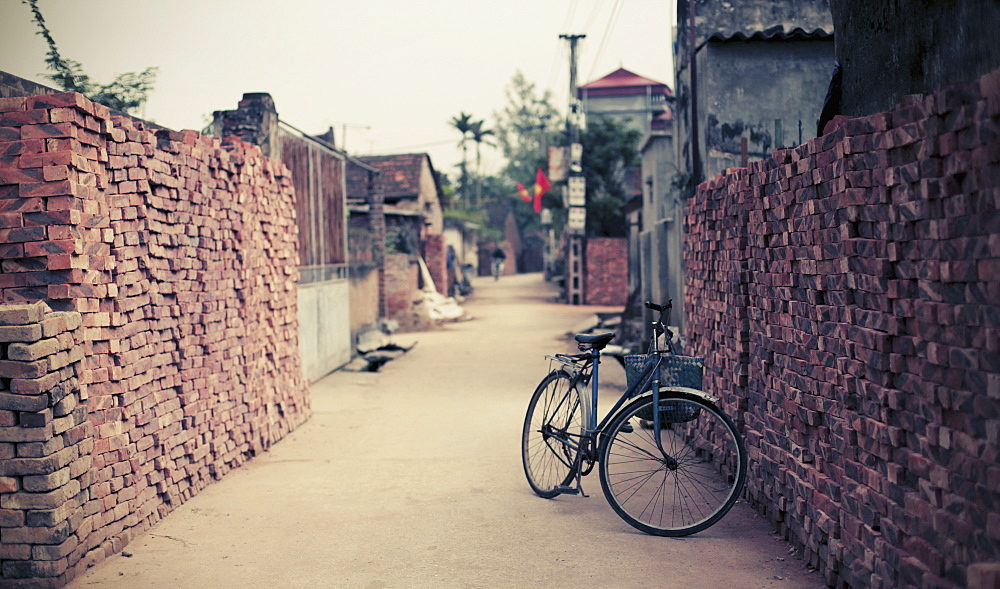 Bicycle parked narrow street in Hanoi, Vietnam