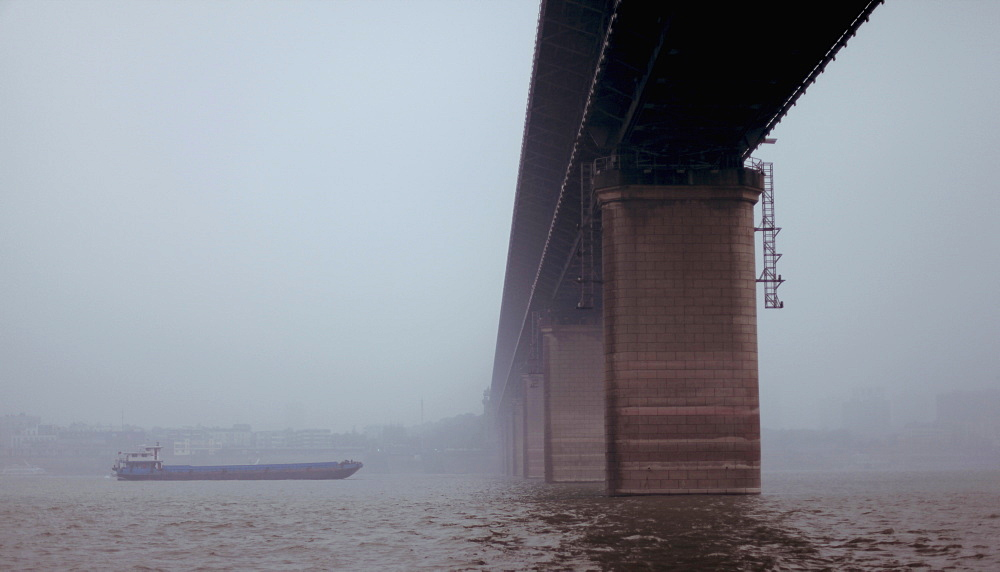 Low angle view of bridge over river against clear sky, Wuhan, China