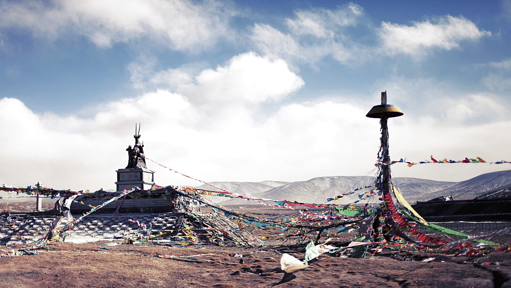 Tangled bunting on mountain against cloudy sky, Yushu Tibetan Autonomous Prefecture, China