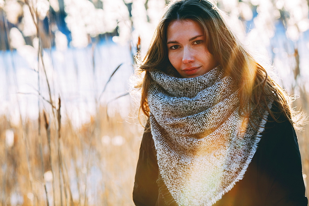 Portrait of young beautiful woman standing outdoors