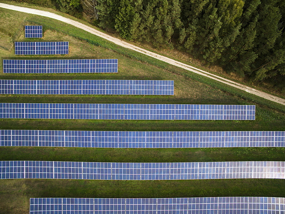 Aerial view of solar panels in field