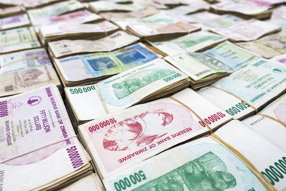Full frame shot of paper currencies arranged on table