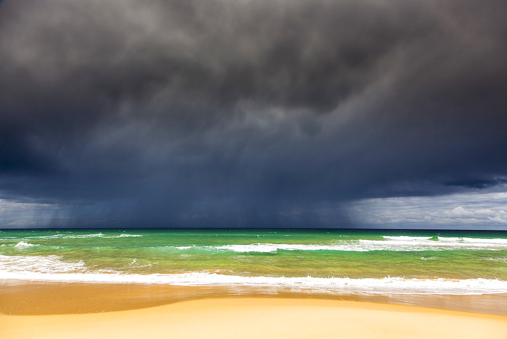 Idyllic view of storm clouds over beach
