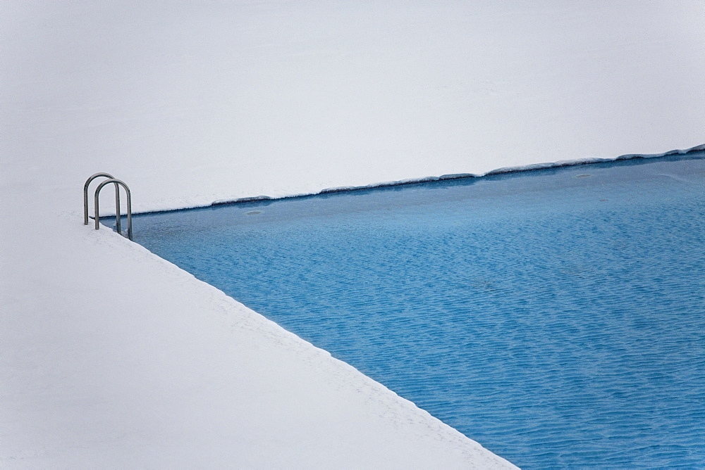 High angle view of swimming pool on snowy field
