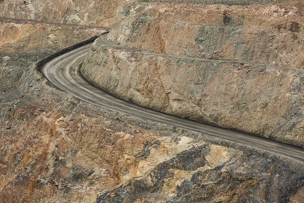 High angle view of empty dirt road at open-pit mine, Kalgoorlie, Western Australia, Australia