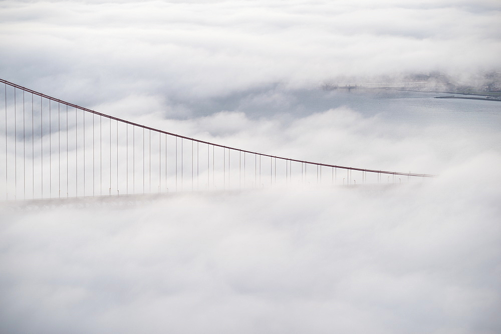 View of Golden Gate Bridge surrounded by fog over San Francisco Bay, California, USA