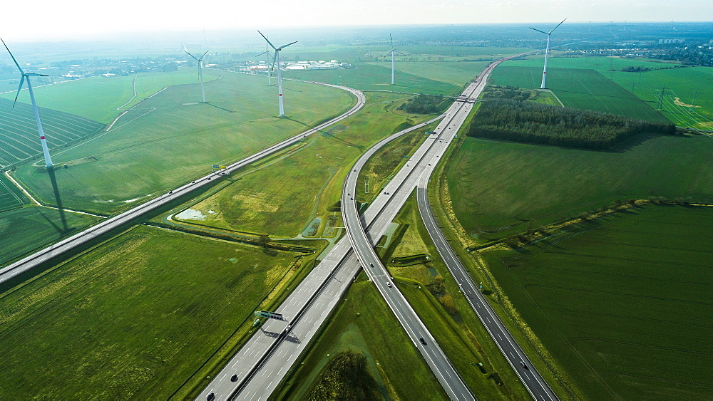 Aerial view of highways by wind turbines on field, Berlin, Brandenburg, Germany