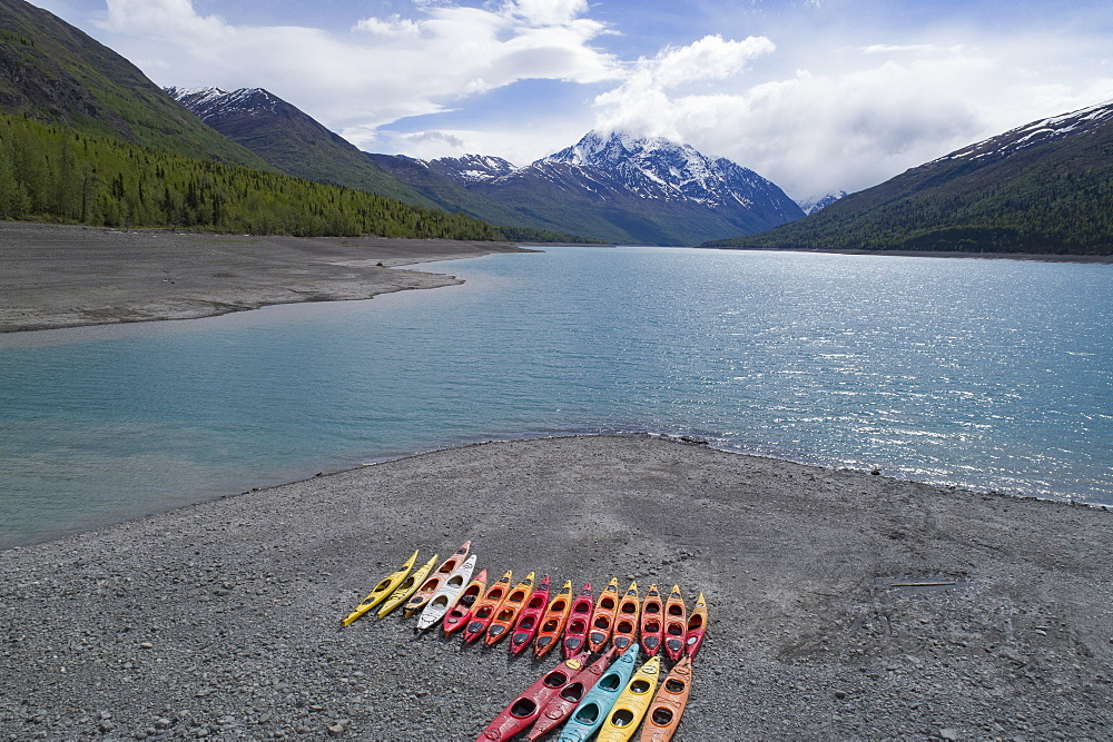 Colorful canoes at beach against sky, Anchorage, Alaska