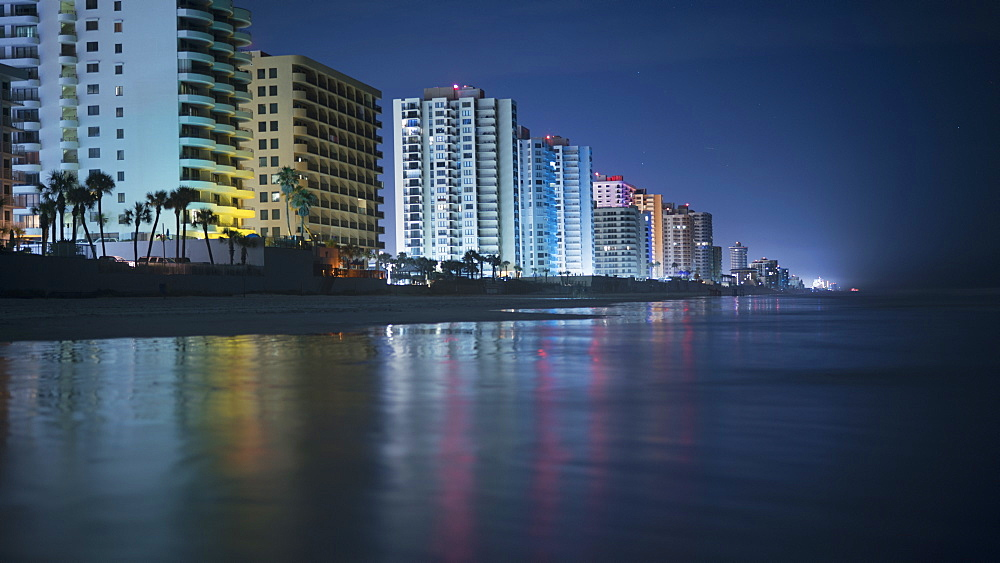 Illuminated buildings by beach in city at night, Daytona, Florida, USA