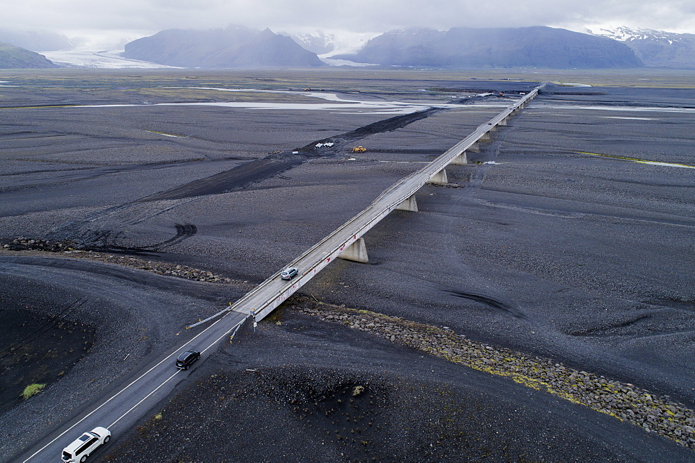 Aerial view of vehicles on bridge against mountains, Iceland - 1177-1894