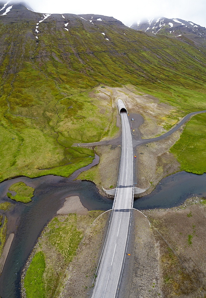 Drone view of road over stream, Iceland
