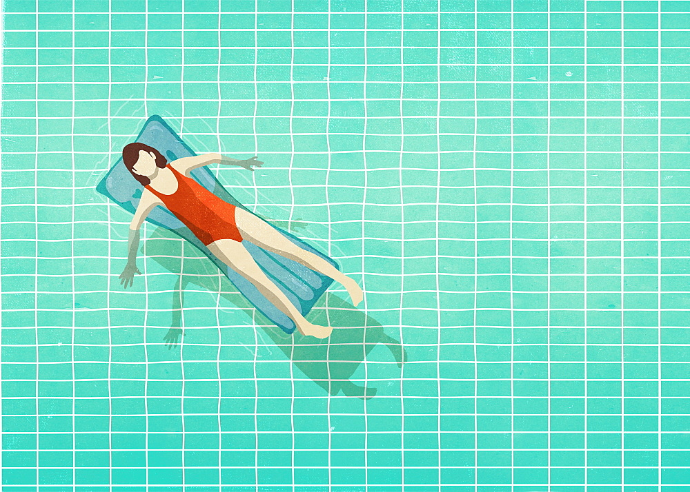 Woman in bathing suit laying on inflatable raft in swimming pool