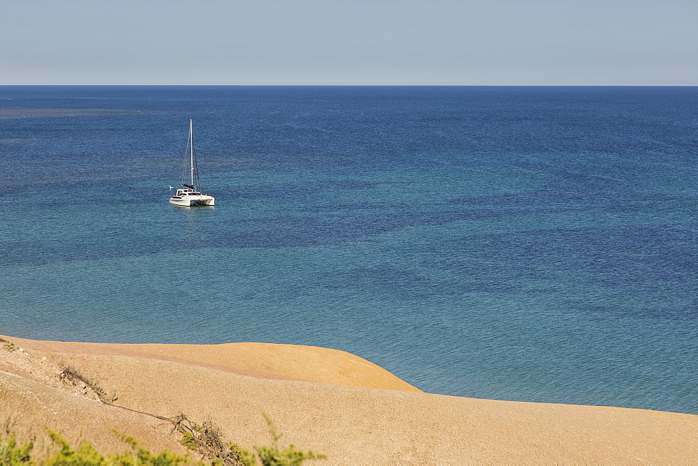 Catamaran on sunny, tranquil ocean, Port Willunga, South Australia, Australia