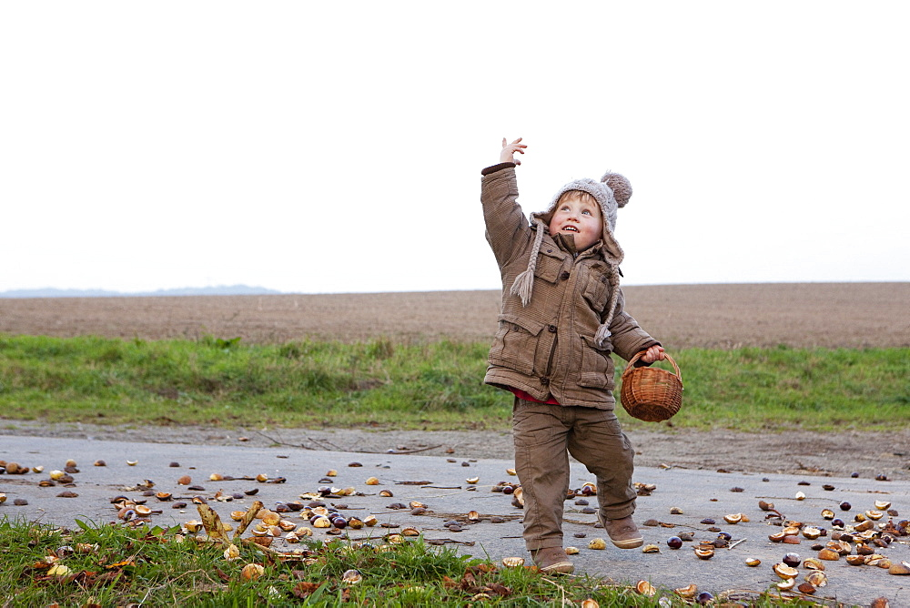 Playful girl with basket on rural road - 1177-1968