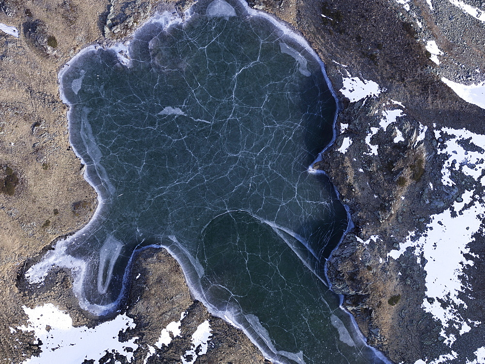 Aerial view frozen glacial lake, Ischgl, Tyrol, Austria