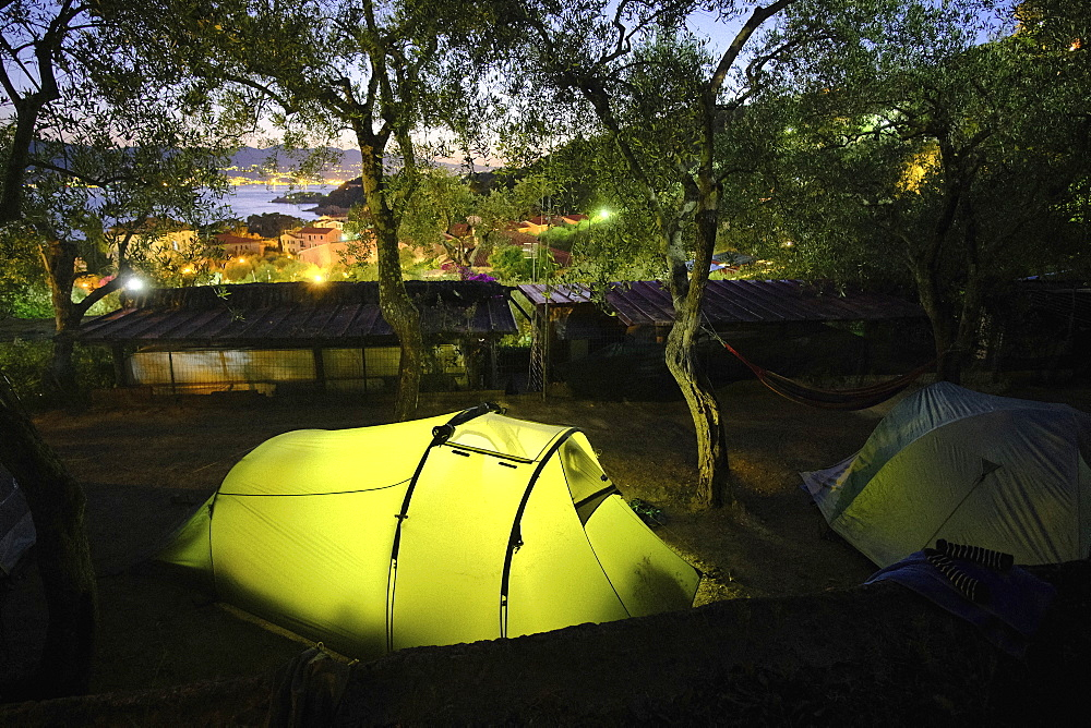 Glowing campsite tent at dusk, Tellaro, Tuscany, Italy