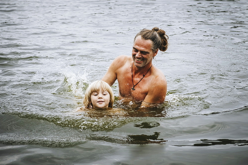 Father and son swimming in lake - 1177-2078