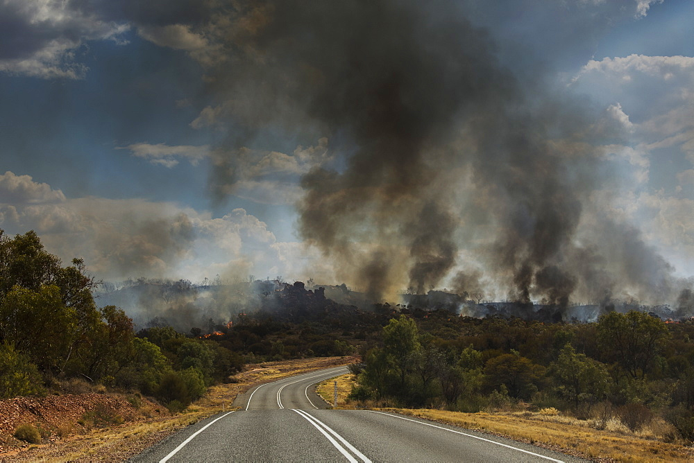 Forest fires burning in distance, East McDonnell Ranges, Alice Springs, Australia