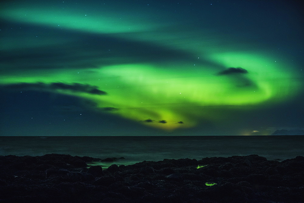 Mysterious Northern Lights over ocean, Reykjanesbaer, Iceland