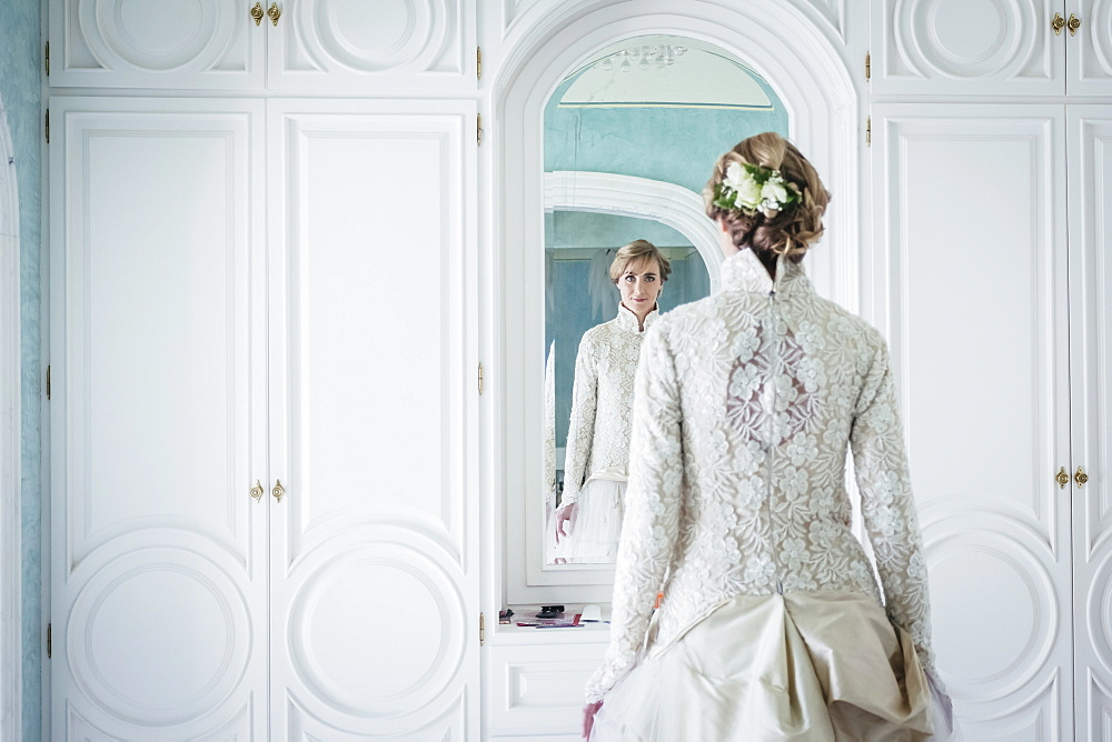 Elegant bride in lace wedding dress at mirror - 1177-2196