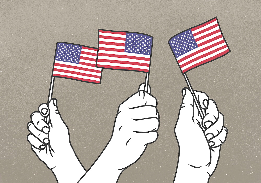 Hands waving small American flags