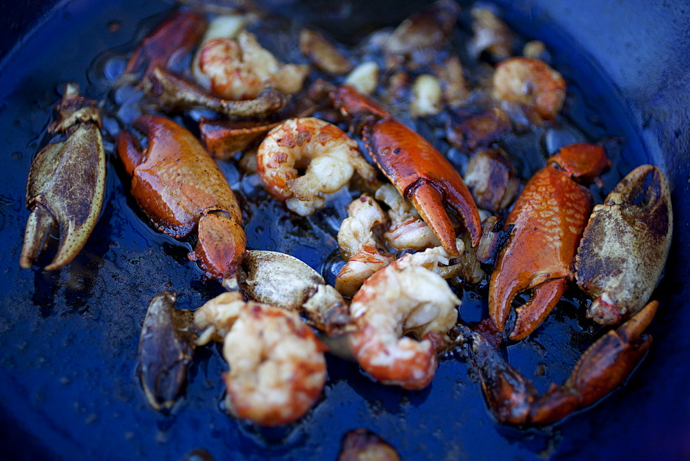Freshwater yabby claws and prawns in cooking oil in pan