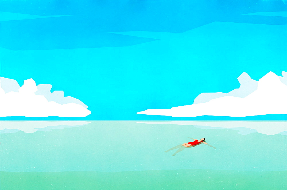 Serene woman floating on back in sunny turquoise ocean