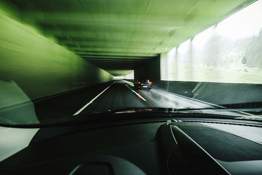 Car point of view driving in tunnel