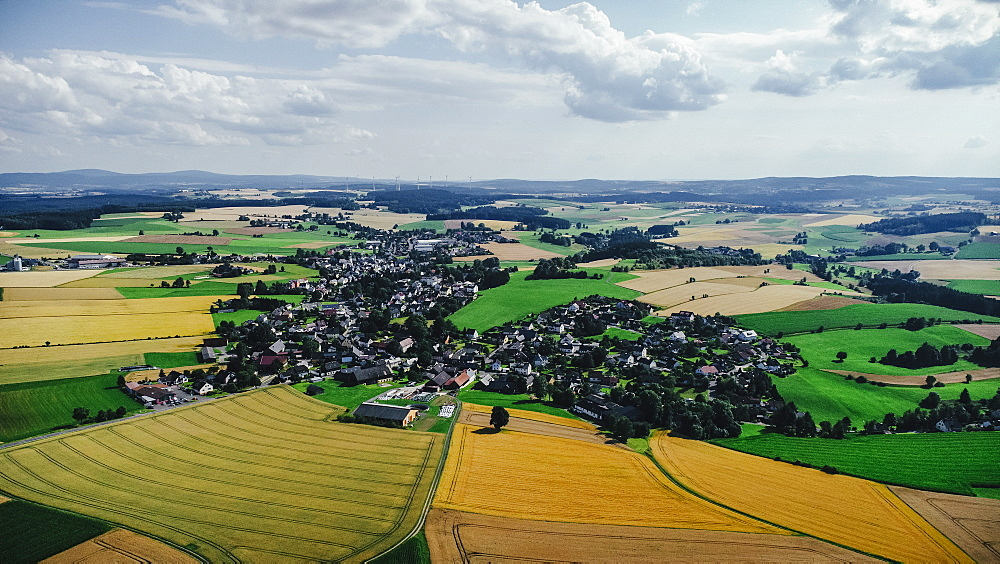 Drone point of view sunny view farmland and rural townscape, Bayern, Germany