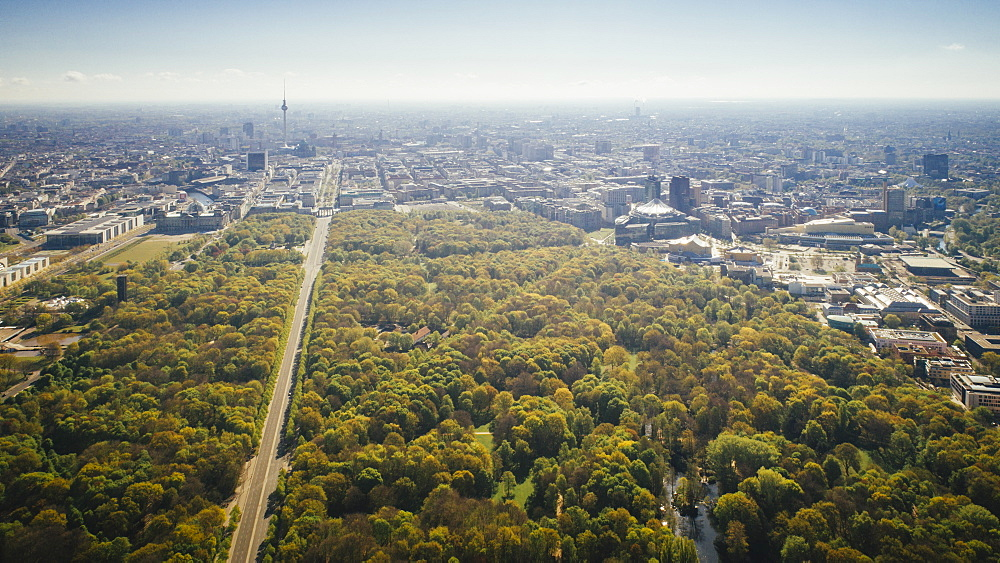 Drone point of view sunny Tiergarten Park and Berlin cityscape, Germany