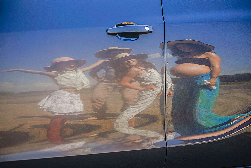 Reflection of pregnant woman and family on sunny car door - 1177-2363