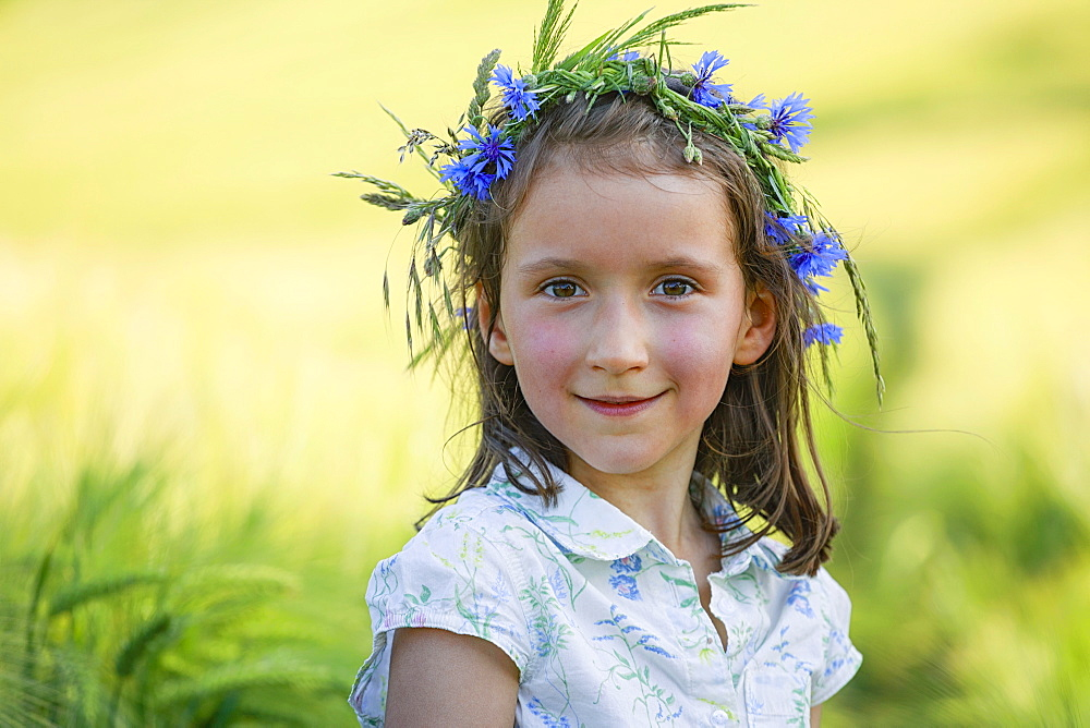 Portrait smiling girl with flowers in hair