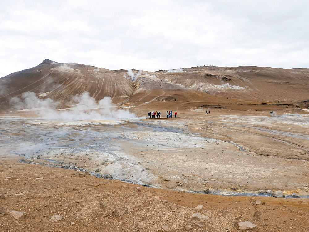 Tourists visiting remote hot spring, Iceland