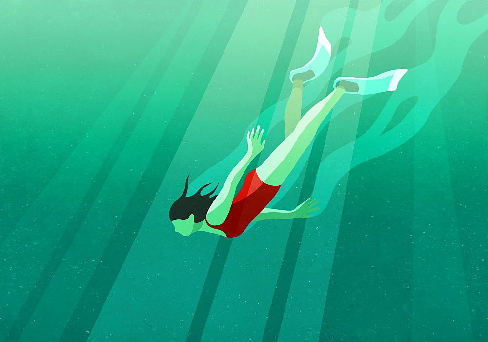 Woman diving underwater in ocean