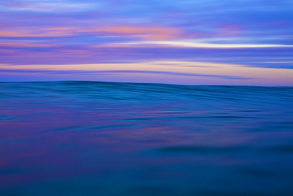 Tranquil blue and pink ocean and sky at sunrise, Sayulita, Nayarit, Mexico