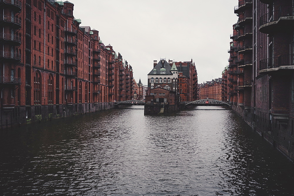 Hafencity canal between brick warehouse buildings, Hamburg, Germany