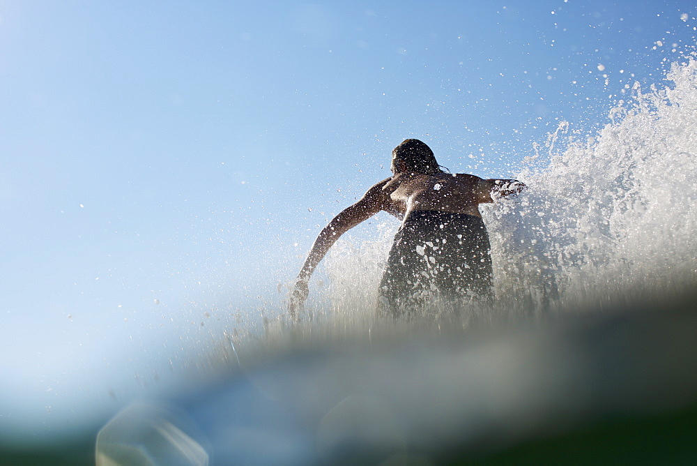 Male surfer riding wave