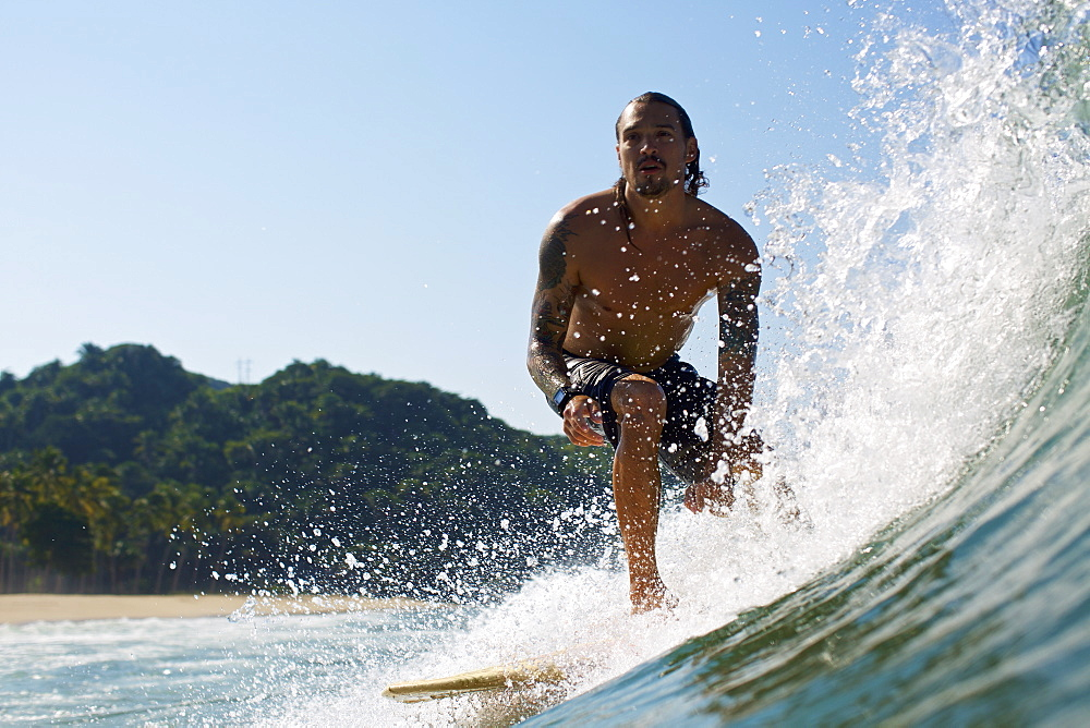 Male surfer riding sunny ocean wave - 1177-2741