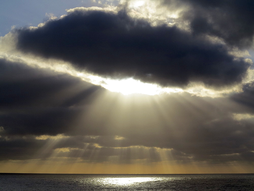Sunbeams breaking through stormy sky over ocean, Santa Cruz de La Palma, Spain