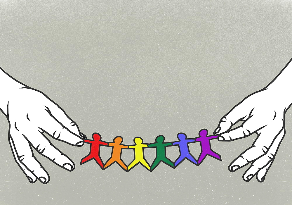 Hands holding LGBTQI rainbow paper chain
