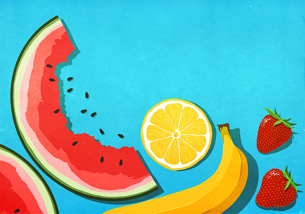 Fresh, juicy fruits on blue background
