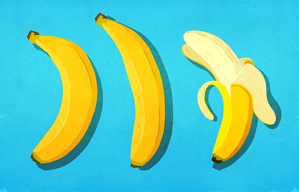 Peeled and unpeeled bananas on blue background