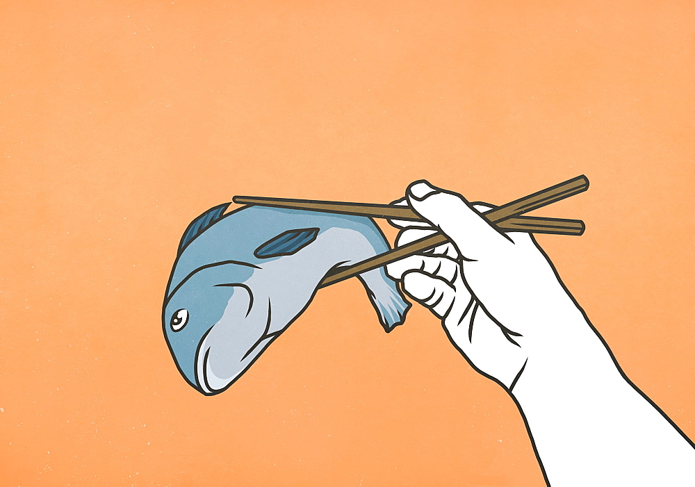 Chopsticks holding whole dead fish