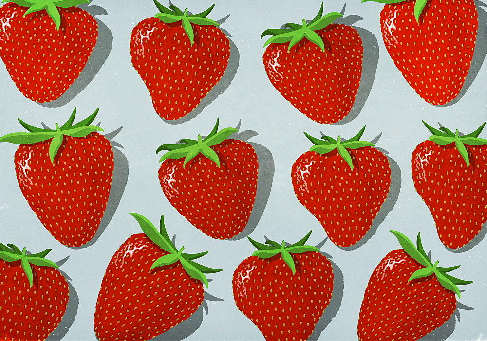 Vibrant red strawberries on gray background